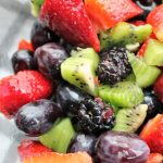 Kiwi, strawberry, grape and blackberry in a clear bowl