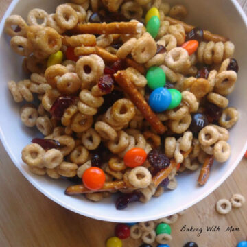 cheerios, chocolate, pretzels in a bowl