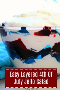 Red and Blue Jello with white whipping cream in a glass bowl