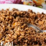 Rice and Hamburger in a white serving dish with a serving spoon