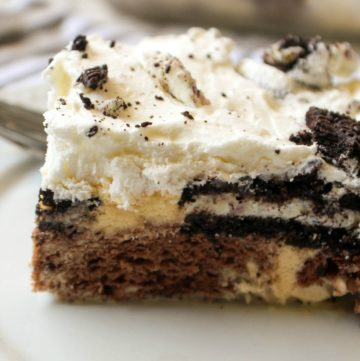 OREO Dessert on a white plate with ice cream and whipped topping