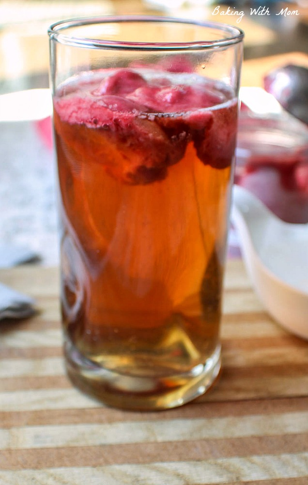 Glass of raspberry sorbet ice tea on a cutting board