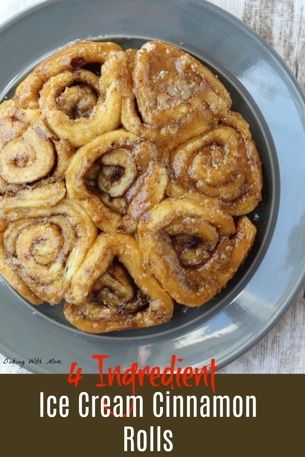Cinnamon rolls on a gray plate with a brown sugar topping with butter