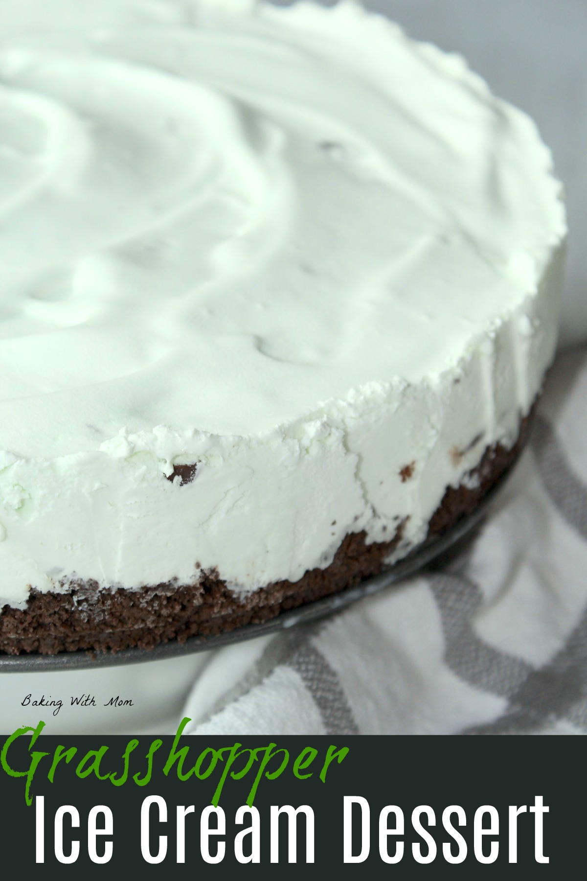 mint ice cream with cookie crust and a white towel laying besides