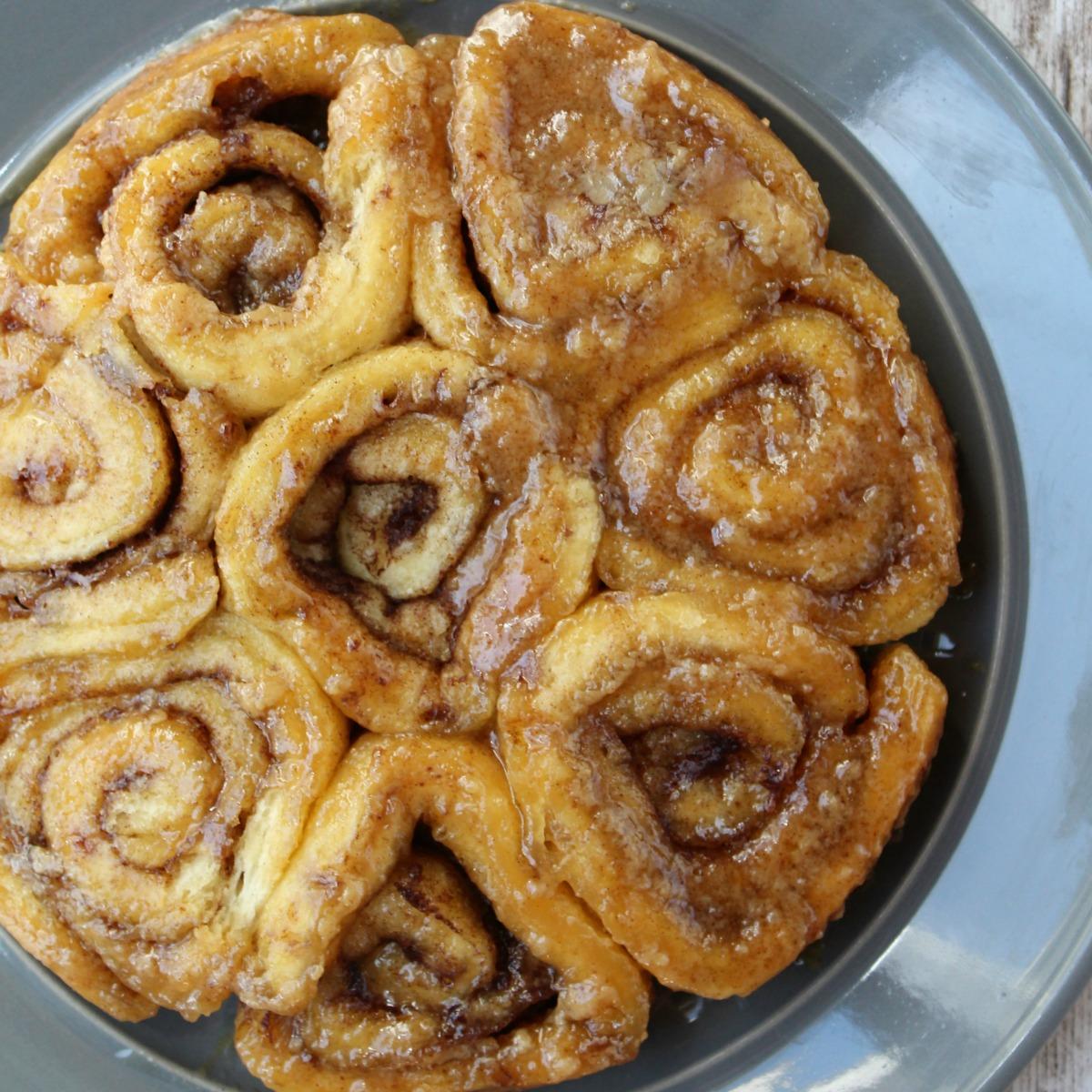 brown sugar cinnamon rolls on a gray plate