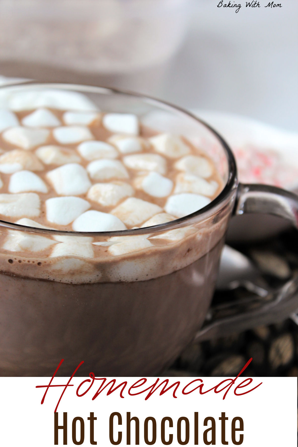 cup of hot chocolate in a glass mug with marshmallows floating on top