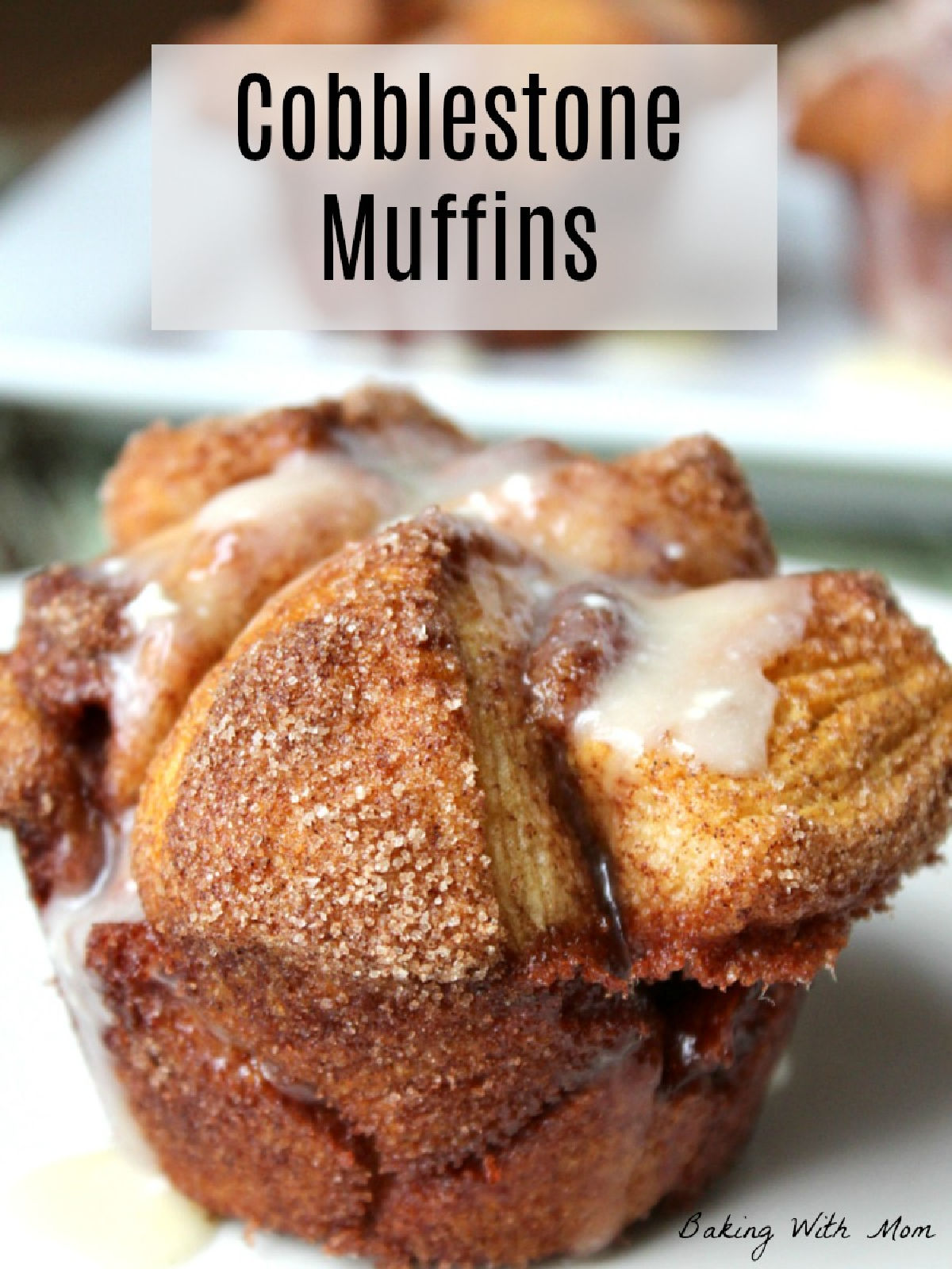 cinnamon sugar muffin sitting on a white plate drizzled with white frosting.
