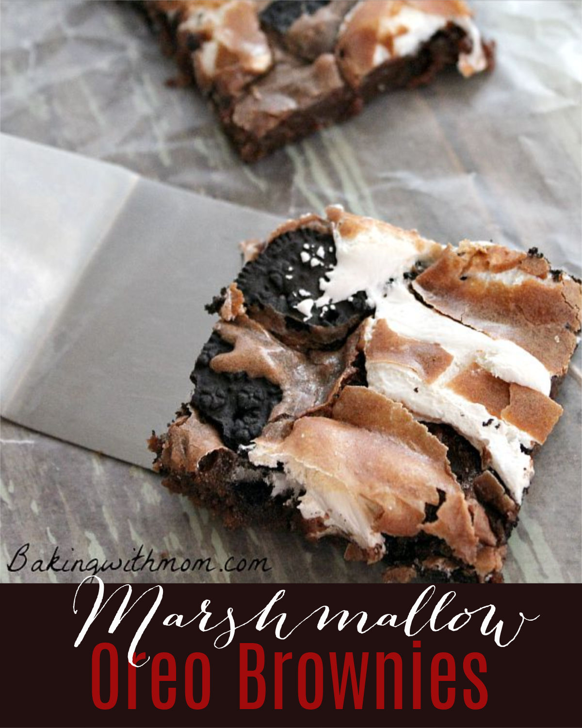 Spatula holding a chocolate brownie with marshmallow swirled within.