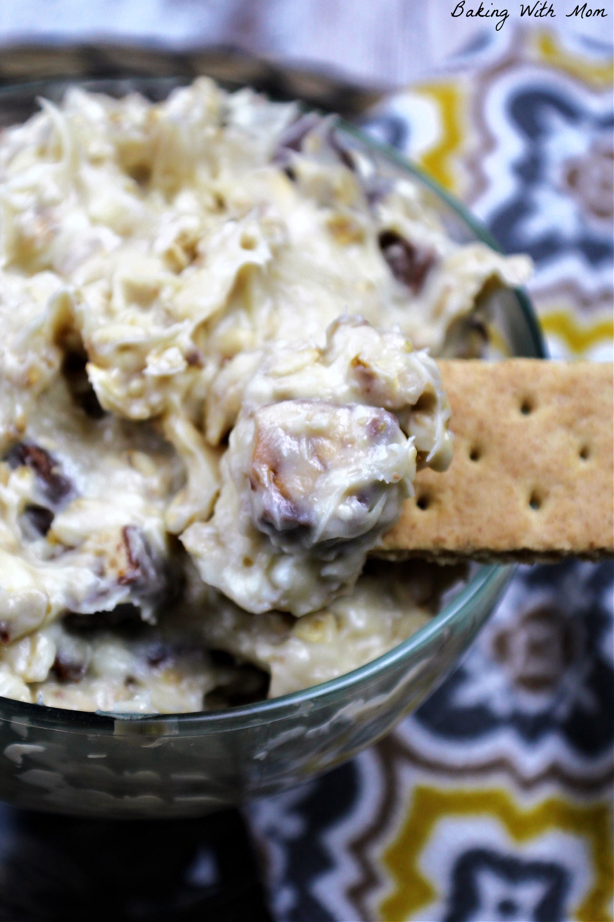Graham crackers dipped in a creamy snickers dip.