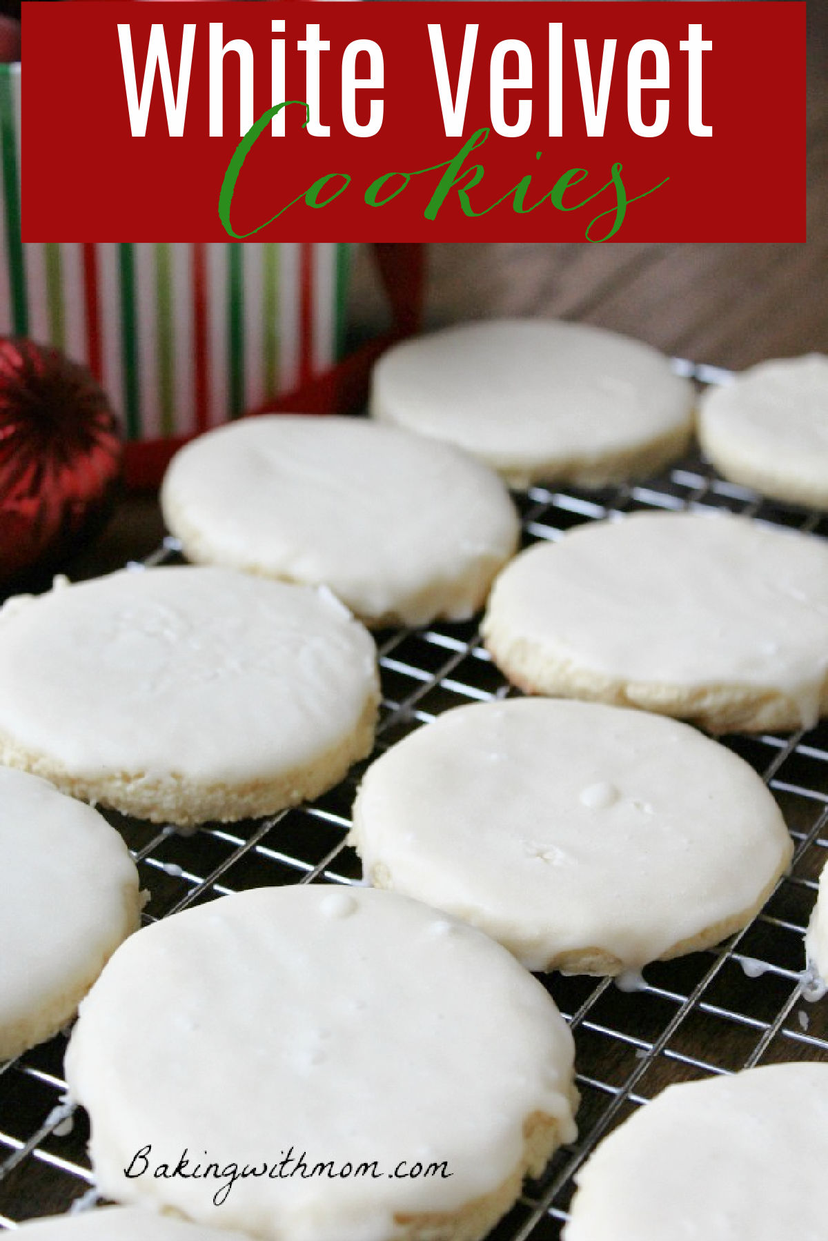 Cookies sitting on a cooling rack covered in white drizzled frosting.