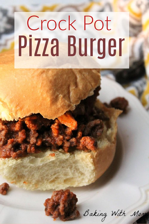 Pizza burger sitting on a hamburger bun on a white plate.