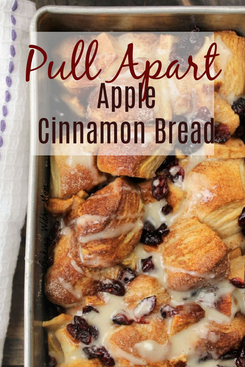 Apple cinnamon bread in a loaf pan with frosting drizzled on top.
