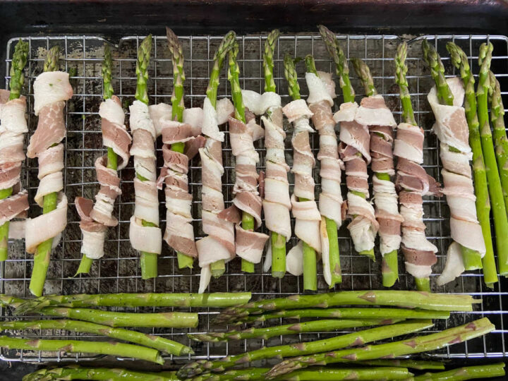 raw bacon wrapped around asparagus