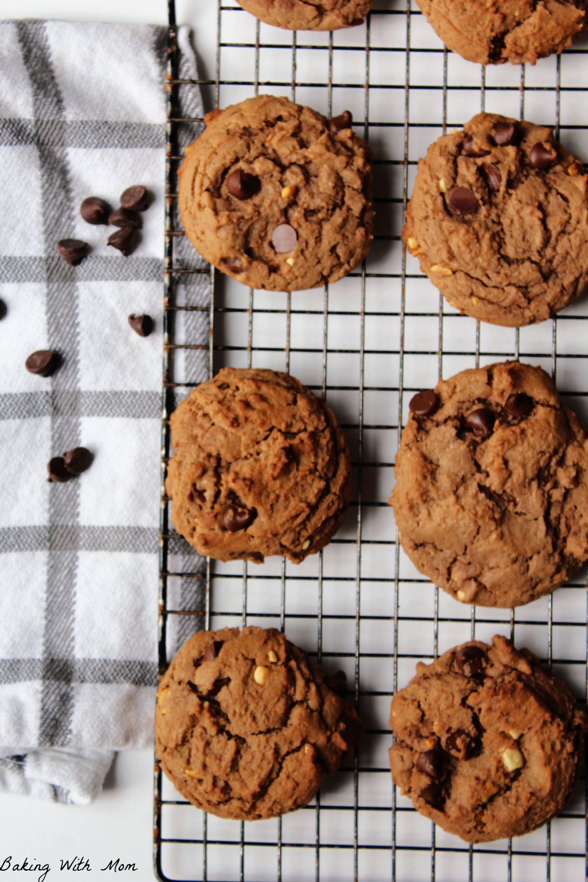Peanut butter and chocolate cookies on a cooling rack.