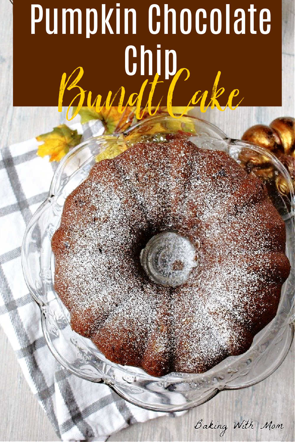 Pumpkin cake on a cake platter with fall decoration lying besides.
