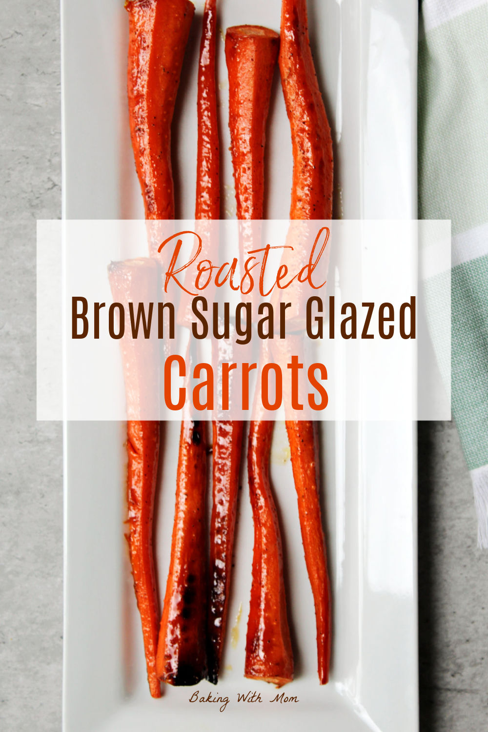 Roasted carrots on a white plate.